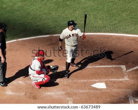 SAN FRANCISCO, CA - OCTOBER 19: Giants vs. Phillies: Cody Ross steps into the batters box with Carlos Ruiz catching game three of the NLCS 2010 October 19, 2010 AT&T Park San Francisco. - stock photo