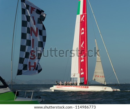 SAN FRANCISCO, CA - OCTOBER 4: Luna Rossa Swordfish skippered by Paul Campbell-James crosses the finish line in the America'??s Cup World Series sailing races in San Francisco, CA on October 4, 2012 - stock photo