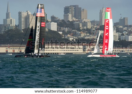 SAN FRANCISCO, CA - OCTOBER 4: Oracle Team USA and Italy's Team Luna Rossa Piranha compete in the America'?s Cup World Series sailing races in San Francisco, CA on October 4, 2012 - stock photo
