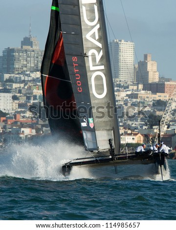 SAN FRANCISCO, CA - OCTOBER 4: The Oracle Team USA sailboat skippered by Russell Coutts competes in the America's Cup World Series sailing races in San Francisco, CA on October 4, 2012 - stock photo