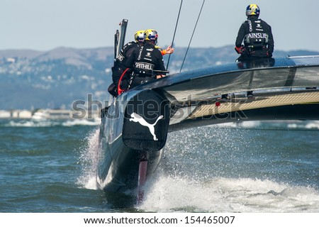 SAN FRANCISCO, CA - SEPTEMBER 12: James Spithall and Ben Ainslie aboard Oracle Team USA during in the America's Cup races in San Francisco, CA on September 12, 2013 - stock photo