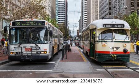 SAN FRANCISCO, CA, USA - OCTOBER 15, 2014: Bus and tram wait at an intersection in downtown San Francisco, CA, USA on October 15, 2014. - stock photo