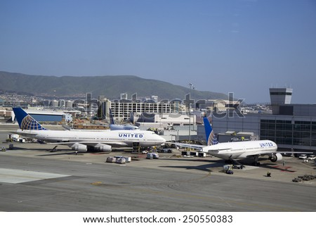 SAN FRANCISCO, CALIFORNIA - APRIL 13, 2014: United Airlines planes at the Terminal 3 in San Francisco International Airport.  - stock photo