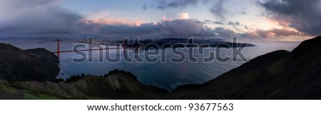 San Francisco, California, Golden Gate Bridge, and Bay Area at sunset - stock photo