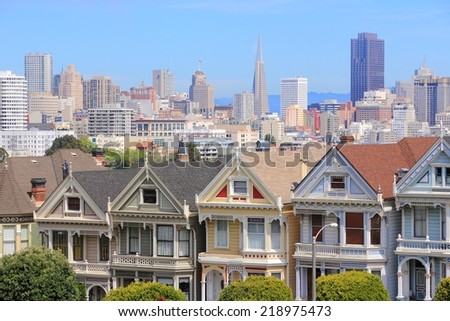 San Francisco, California, United States - city skyline with famous Painted Ladies, Victorian homes at Alamo Square (Western Addition neighborhood). - stock photo