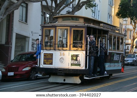 San Francisco, California, USA - December 23, 2015: The San Francisco cable car system, an icon of San Francisco, is the world's last manually operated cable car system.  - stock photo