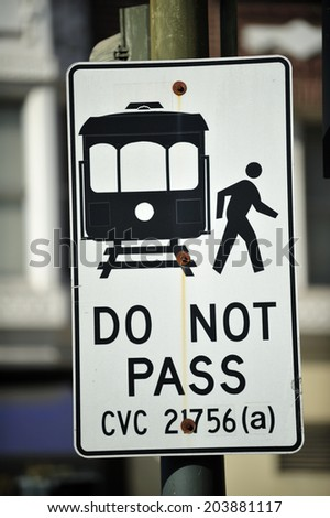 SAN FRANCISCO, California, USA, - NOVEMBER. 10. 2011: The stop sign of cable car tram on the street in San Francisco, world's last manually-operated cable car system, icon of San Francisco - stock photo