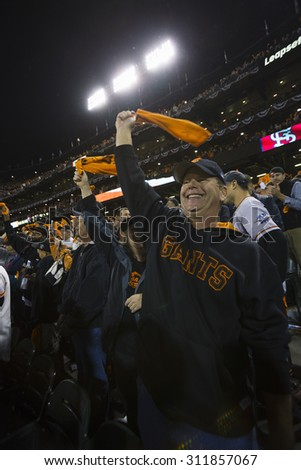 San Francisco, California, USA, October 16, 2014, AT&T Park baseball stadium, SF Giants versus St. Louis Cardinals, National League Championship Series (NLCS), excited crowd Giants win 2014 NL Pennant - stock photo