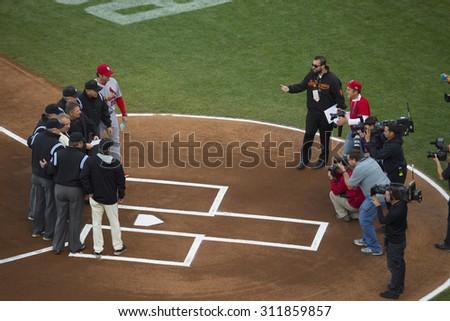 San Francisco, California, USA, October 16, 2014, AT&T Park, baseball stadium, SF Giants versus St. Louis Cardinals, National League Championship Series (NLCS), Umpires and Manager Mike Matheney Cards - stock photo