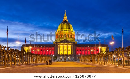 San Francisco City Hall in red and gold light in honor of the Forty Niners trip to the 2013 Super Bowl. - stock photo