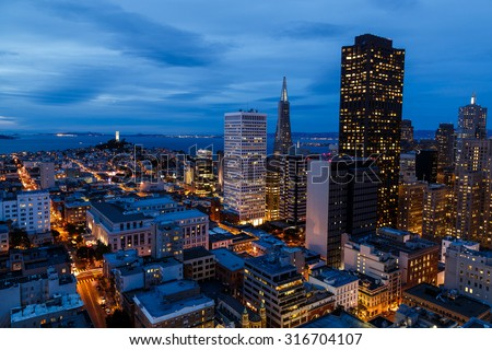 San Francisco cityscape and bay at night - stock photo
