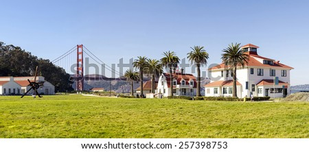 San Francisco coastline park panorama with old houses and Golden Gate bridge - stock photo