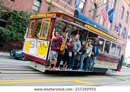 SAN FRANCISCO - FEBRUARY 15: Passengers enjoy a ride in a cable car onFebruary 15, 2015 in San Francisco - stock photo