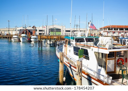 San Francisco Fisherman's Wharf harbor with moored boats on a clear sunny day. Copy space - stock photo