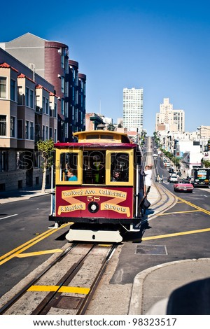 SAN FRANCISCO - JULY 22: Passengers enjoy a ride in a cable car on July 22, 2011 in San Francisco. It is the oldest mechanical public transport in San Francisco which is in service since 1873. - stock photo