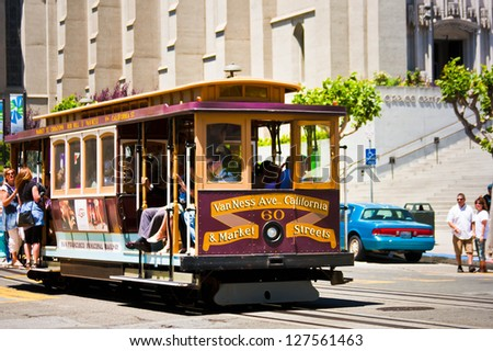 SAN FRANCISCO - JUNE 27: People riding in a cable car on June 27, 2009 in San Francisco, CA. It is the oldest mechanical public transport in San Francisco which is in service since 1873. - stock photo