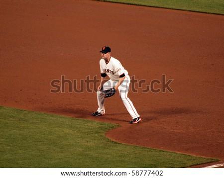 SAN FRANCISCO - MAY 12: Giants Vs. Padres: Giants first baseman Aubrey Huff squats at first waiting for start of play during a night game.  Taken May 12 2010 at Att Park San Francisco California - stock photo