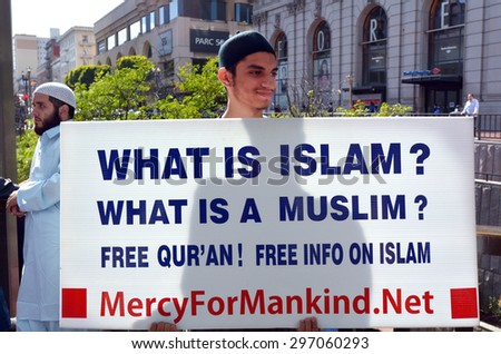 SAN FRANCISCO - MAY 17 2015:Muslim man holds What is Islam sign during a protest.New reports show that Islam is growing rapidly than any other religion in the world and will equal Christianity by 2050 - stock photo