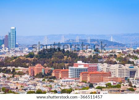 San Francisco Oakland Bay Bridge behind the city - stock photo