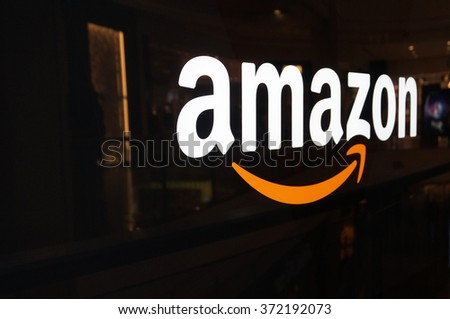 SAN FRANCISCO - OCTOBER 11:  Amazon logo on black shiny wall in mall California October 11, 2015.  Amazon is a American international electronic commerce company and world's largest online retailer. - stock photo
