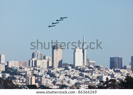 SAN FRANCISCO - October 9: Formation of 4 Planes fly over skyscrapers in city of San Francisco during Fleet Week Airshow on October 9, 2011 in SAN FRANCISCO, CA, USA. - stock photo
