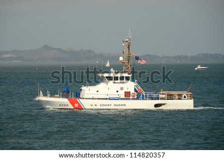 SAN FRANCISCO - OCTOBER 2: US Coast Guard cutter patrols the San Francisco Bay area on October 2, 2012 ahead of the Americas Cup sailing race. - stock photo
