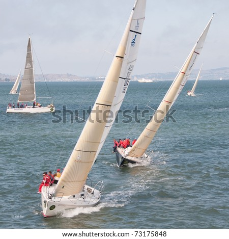 SAN FRANCISCO - SEPT 12: two j105s on starboard tacks, compete at the 45th Rolex Big Boat Series on Sept 12, 2009 in San Francisco Bay, California - stock photo