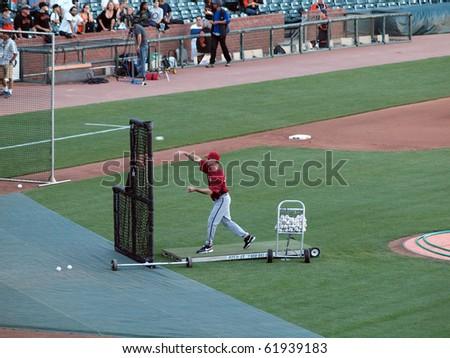 SAN FRANCISCO - SEPTEMBER 28: Diamondbacks vs. Giants: Diamondback Bullpen coach Glenn Sherlock throws pitch during batting practice taken on September 28 2010 at Att Park in San Francisco California. - stock photo