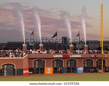 SAN FRANCISCO - SEPTEMBER 28: Diamondbacks vs. Giants:Water Fountains shoot into the air after the national anthem before start of game.  September 28 2010 at Att Park in San Francisco California. - stock photo