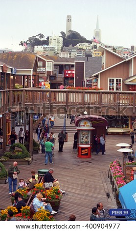 SAN FRANCISCO - SEPTEMBER 20: Famous Fisherman's Wharf on September 20, 2007 in San Francisco, California. The area's tourist attractions draw approximately 12 million visitors a year. - stock photo