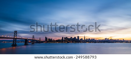 San Francisco skyline at sunset with solo boat - stock photo