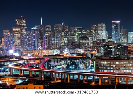 San Francisco skyline with rush hour traffic on the winding highways - stock photo