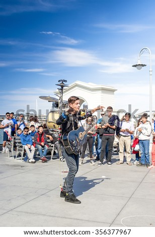 San-Francisco-United States,July 13, 2014: Positive Caucasian Male Multiplayer Musician Performing Outdoors on San-Francisco Pier on July 13, 2014 in San-Francisco, California,United States of America - stock photo