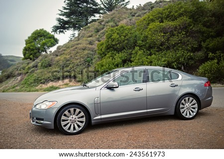 SAN FRANCISCO, USA - JANUARY 11, 2015: A metallic paint Jaguar XF is parked on a Parking lot in San Francisco, USA on January 11, 2015. - stock photo
