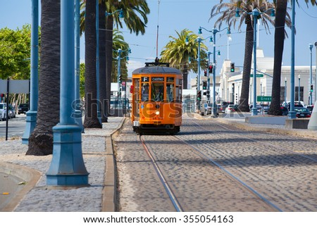 San Francisco - USA - July 17, 2011: Typical San Francisco train  traveling down the Embarcadero on a sunny day. - stock photo