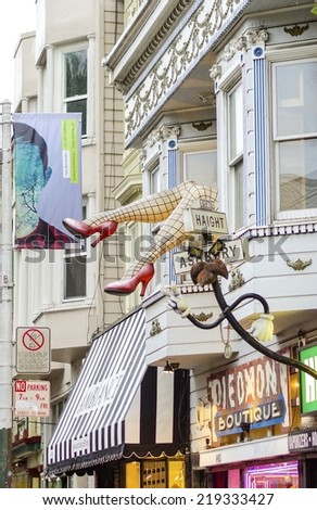 SAN FRANCISCO,USA - MARCH 3 2014: Haight Ashbury neighborhood in California, United States of America,a hippy area.A sculpture with large legs wearing fishnet stockings and red heels out of a window. - stock photo
