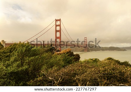 SAN FRANCISCO,USA - MARCH 1 2014: The Golden Gate Bridge in California,United States of America.View of the red suspended bridge connecting Frisco to Marin County at sunset against the pink sky. - stock photo