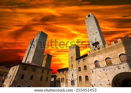 San Gimignano at Sunset - Italy. Buildings and towers in Piazza del Duomo at sunset, San Gimignano medieval town (UNESCO heritage), Siena, Tuscany, Italy - stock photo