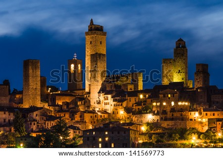 San Gimignano is a small walled medieval hill town in the province of Siena, Tuscany, north-central Italy. - stock photo