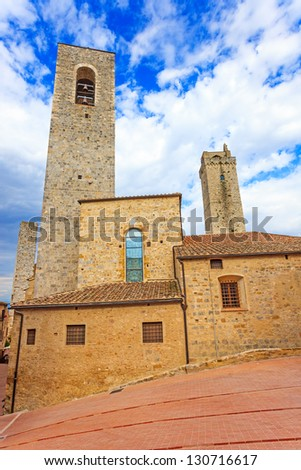San Gimignano landmark medieval town, Tuscany, Italy, Europe. Square, church and towers. - stock photo