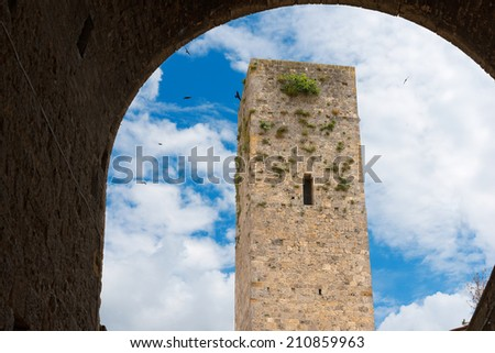 San Gimignano - Siena Tuscany Italy / Detail of the top part of a tower in San Gimignano medieval town (UNESCO heritage), Siena, Tuscany, Italy - stock photo