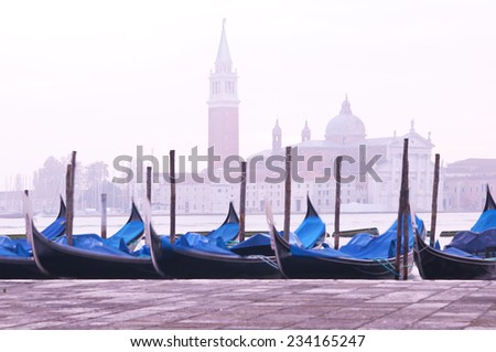 San Giorgio Maggiore church and gondolas at dawn in Venice - stock photo