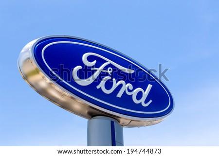 SAN JOSE, CA/USA - MAY 24, 2014: Ford automobile dealership sign. Ford Motor Company is an American multinational automaker headquartered in Dearborn, Michigan. - stock photo
