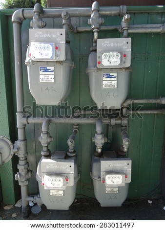 SAN JOSE - MARCH 30: Four PG&E (utility co) electricity SmartMeters which monitor energy quality and provide real time energy consumption data. Assembled in Mexico. San Jose, California March 30, 2015 - stock photo