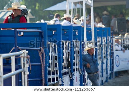 SAN JUAN CAPISTRANO, CA - AUGUST 25: unidentified Cowboys wait to compete in the PRCA Rancho Mission Viejo rodeo in San Juan Capistrano, CA on August 25, 2012. - stock photo