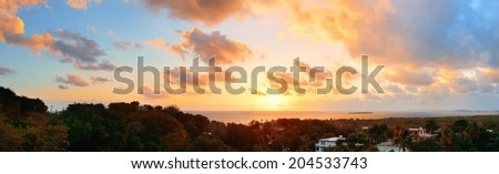 San Juan sunrise panorama view with colorful cloud and beach coastline.  - stock photo