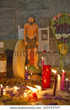 San Lazaro Catholic Church and shrine to Jesus with candles in El Rincon, Cuba - stock photo