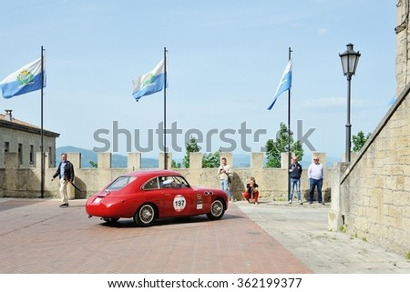 SAN MARINO, RSM - MAY 15: A red FIAT Zagato 1100 E Berlinetta takes part to the 1000 Miglia classic car race on May 15, 2015 in San Marino. The car was built in 1950. - stock photo