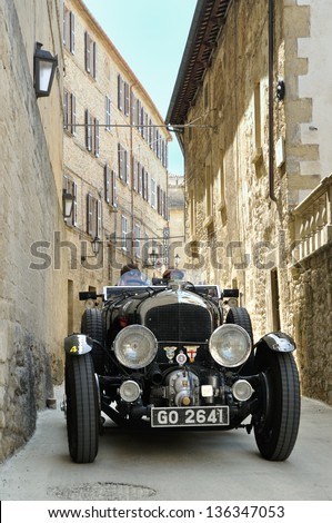 SAN MARINO RSM - MAY 18: Black 1930 Bentley 4,5 Litre Supercharged takes part to the 1000 Miglia 2012, on May 18, 2012 in San Marino - stock photo