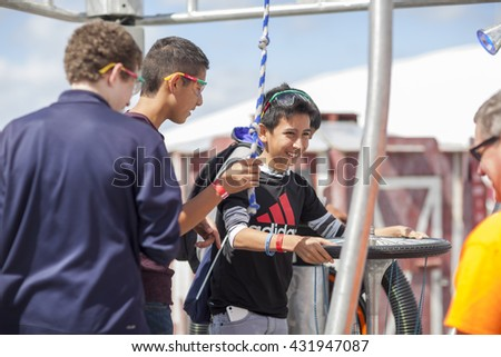 SAN MATEO, CA May 20 2016 - A boy and his friends operate an interactive art piece during the 11th Annual Bay Area Maker Faire at the San Mateo County Event Center. - stock photo